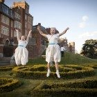 Fun image of bridesmaids jumping in air taken by wedding photographer Kent