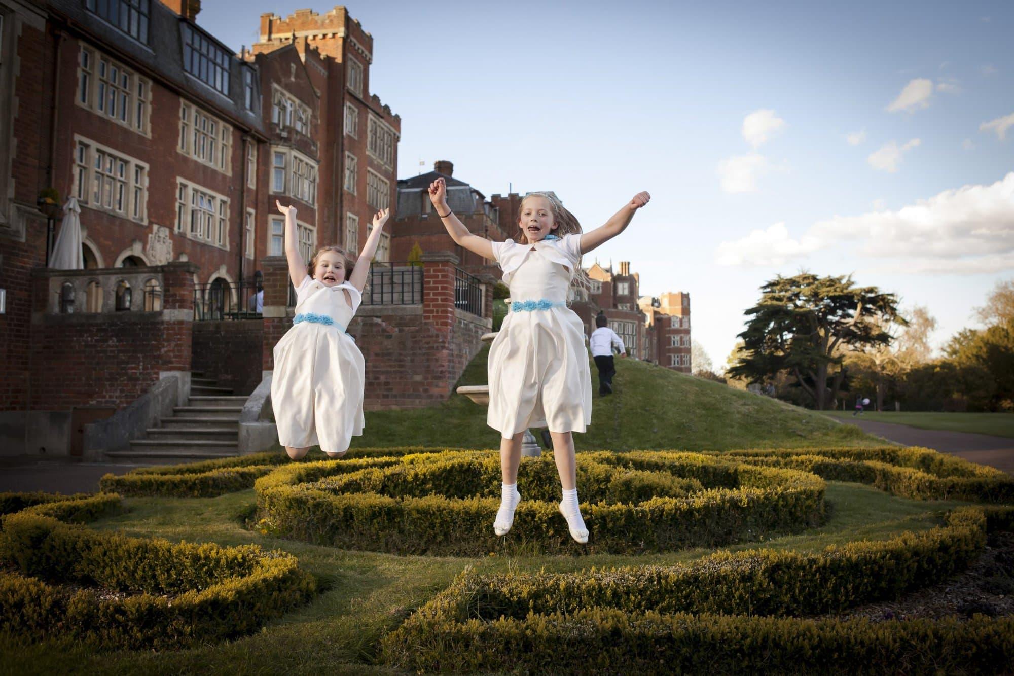 Fun image of bridesmaids jumping in air taken by wedding photographer Kent
