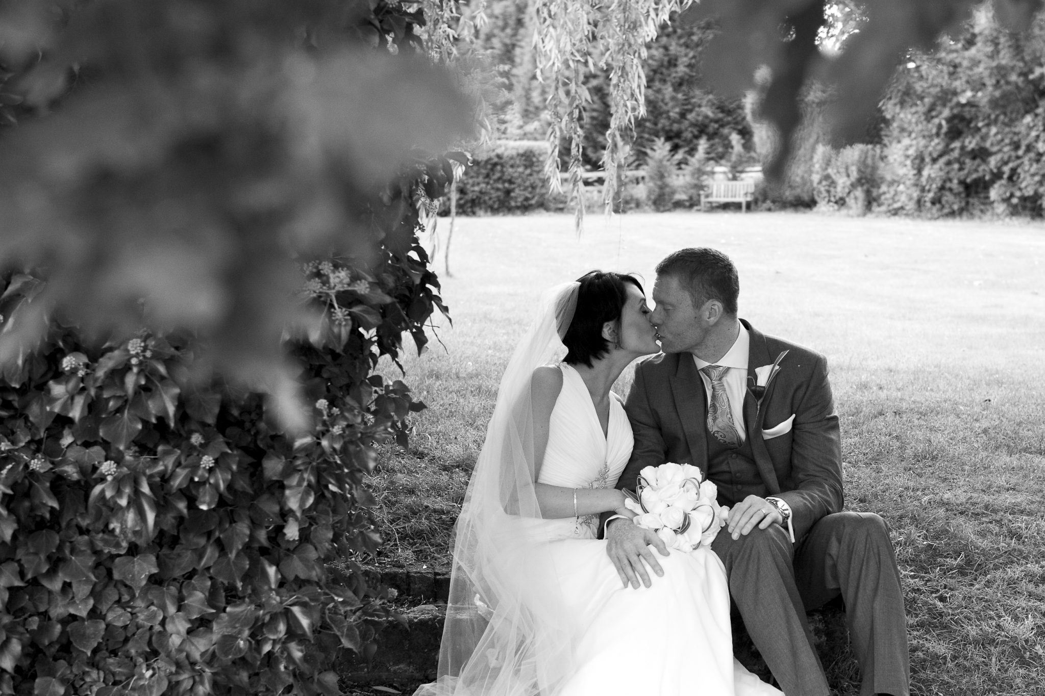 Image of bride and groom kissing at Oaks Farm taken by Kent Wedding Photographer