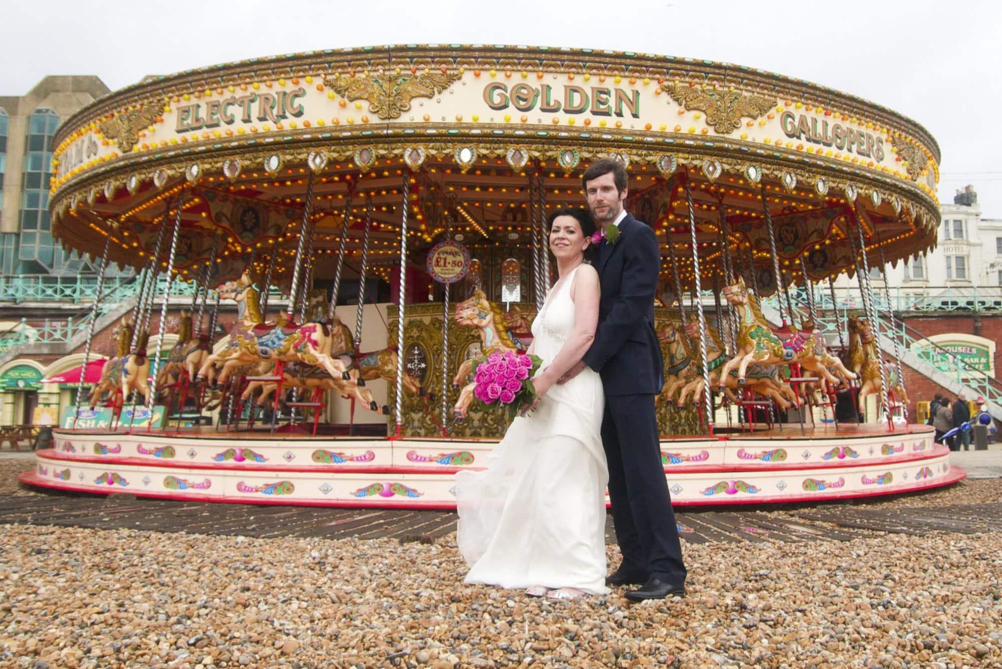 Bride and groom wedding portrait taken at Brighton beach in Sussex