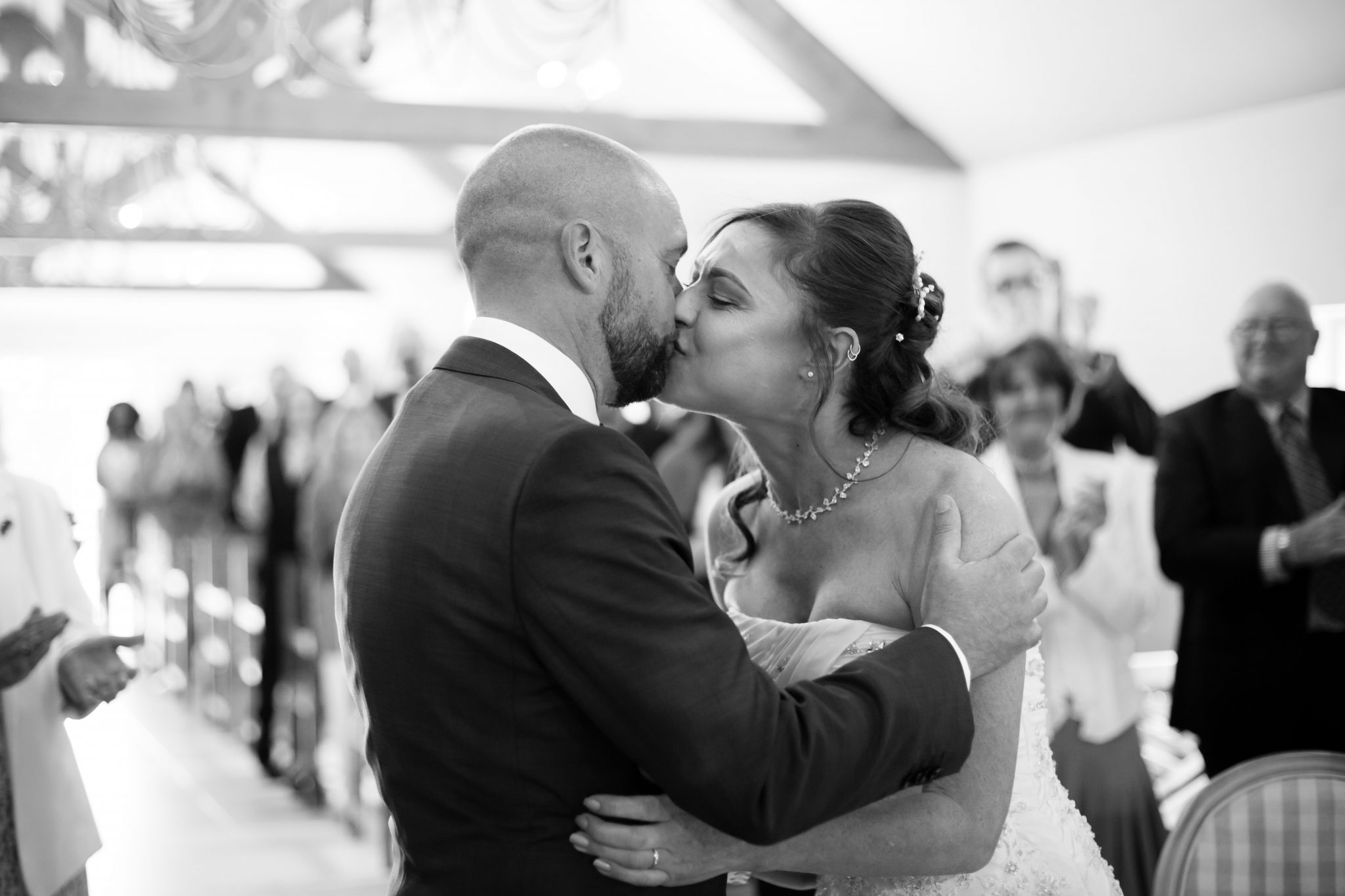 First kiss with bride and groom in ceremony at Oaks Farm, Shirley, Croydon