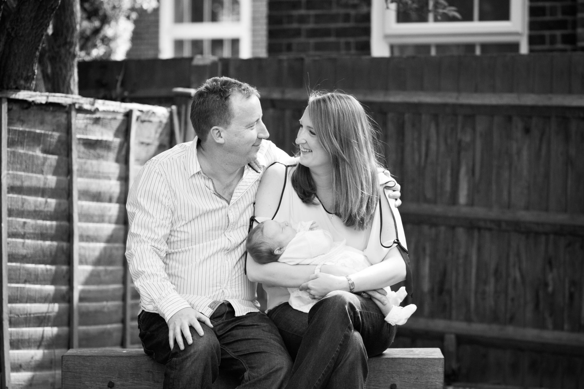 Parents cuddling new baby in family photoshoot in Bromley