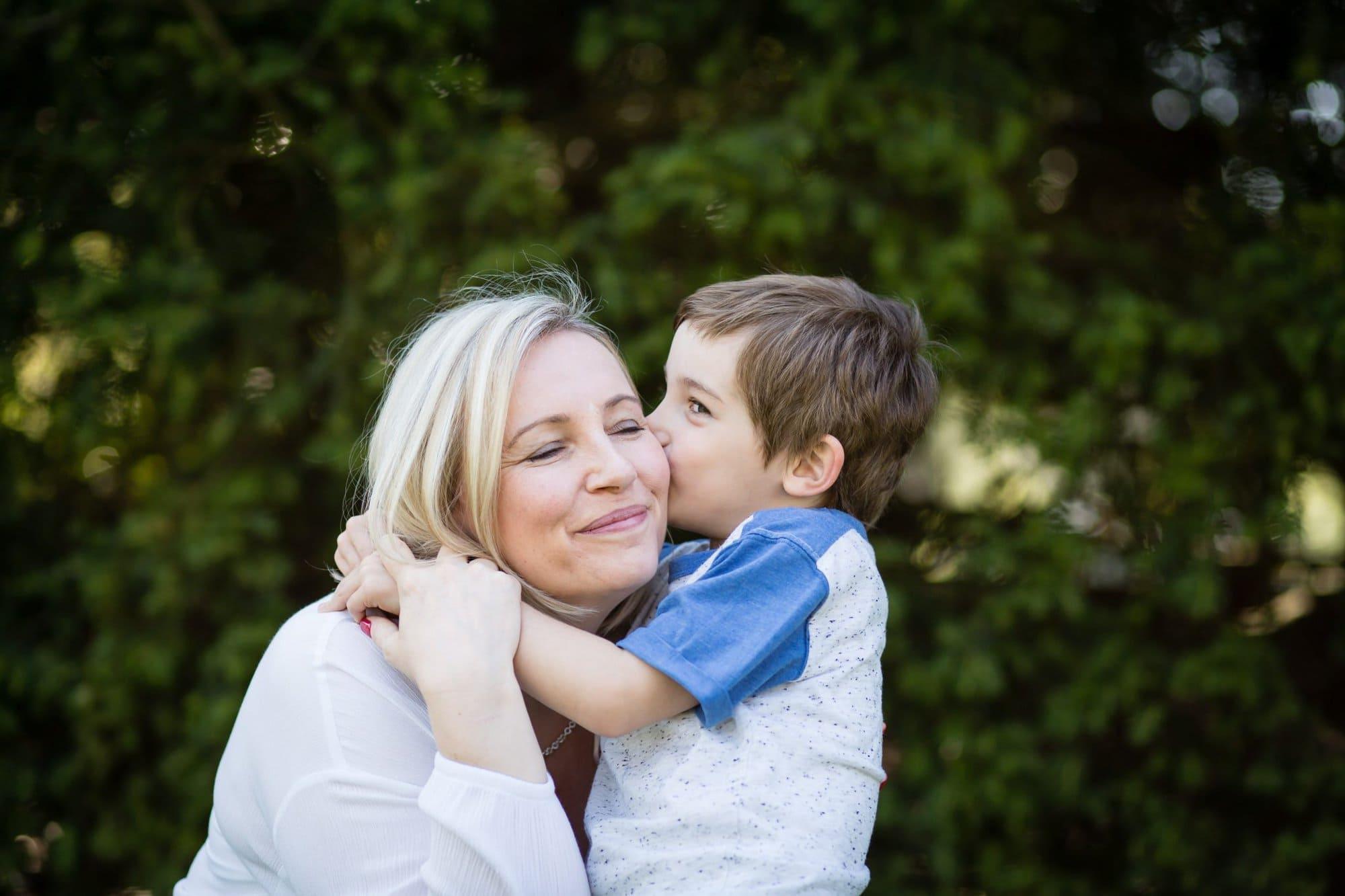 mum and son hugging photo in Beckenham