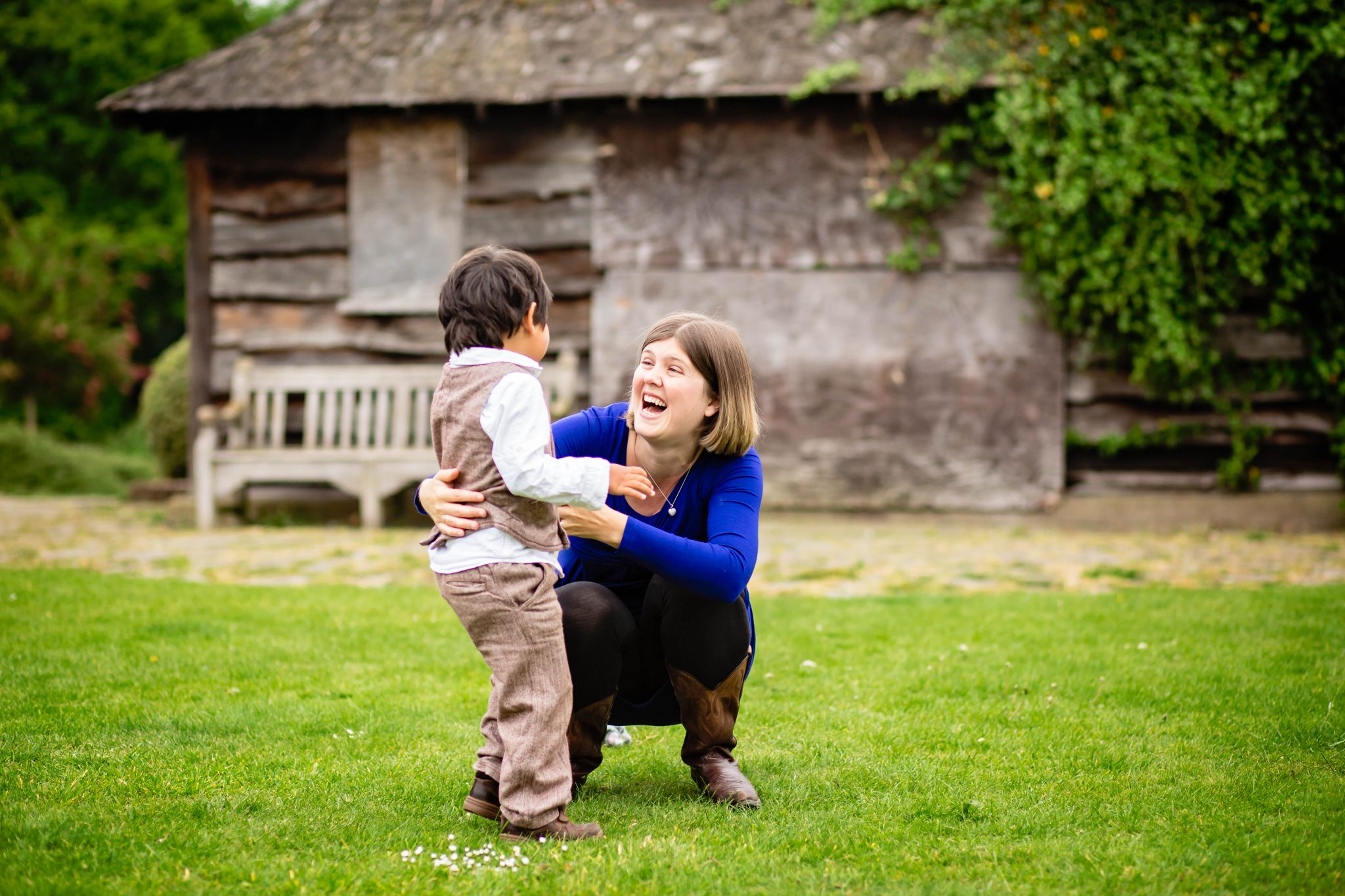 mum and son playing in Beckenham Place park