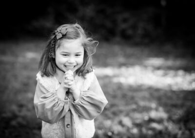 Happy girl outside in park on family photoshoot