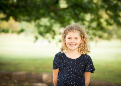 Smiling girl in outdoor park taken by London family photographer
