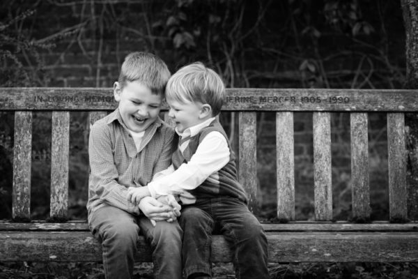 Brothers laughing in black and white family image in Beckenham