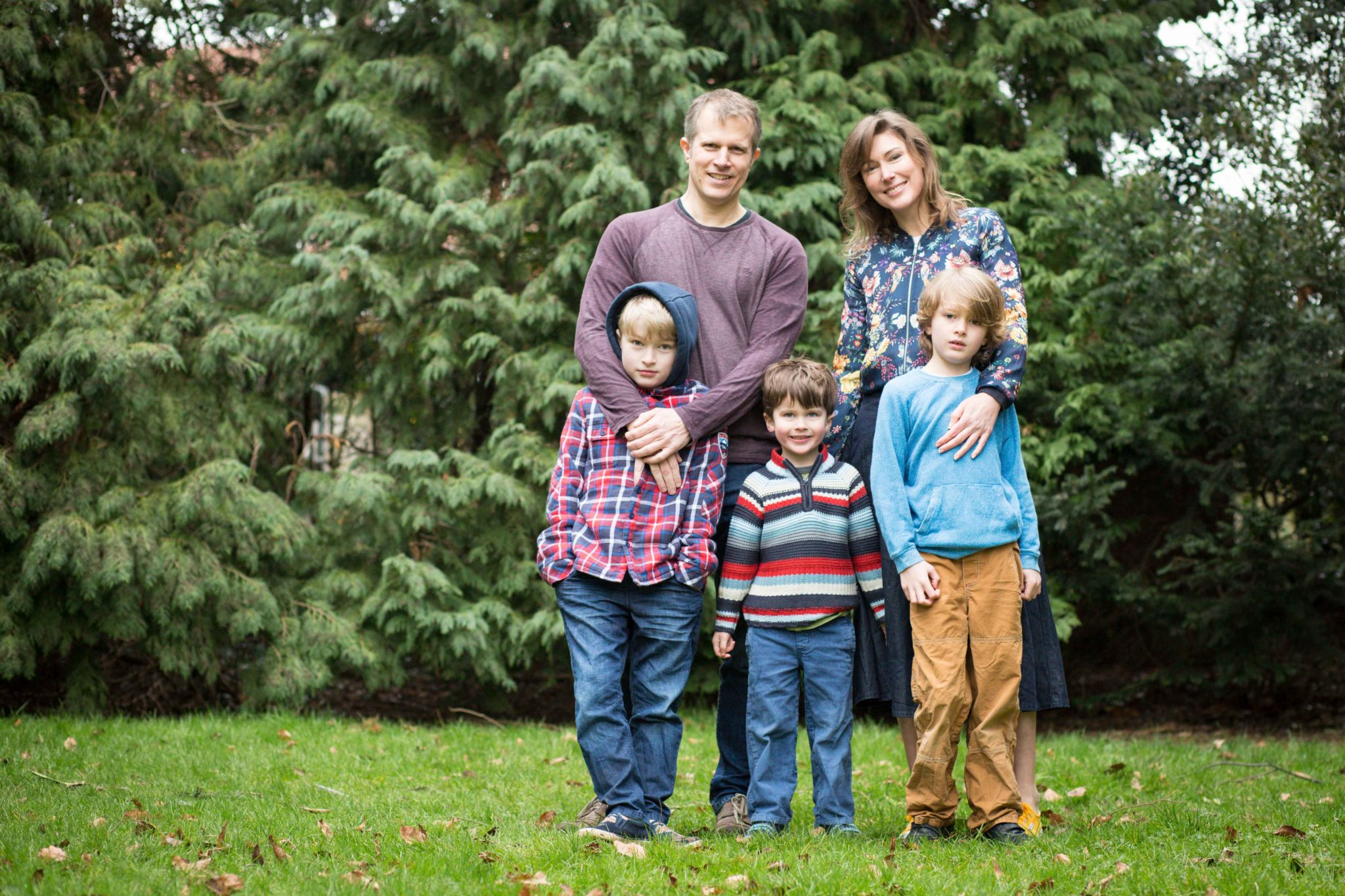 Family in local park relaxing for portrait image