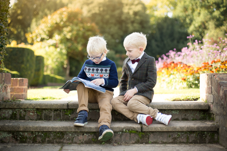 brothers reading in local park Beckenham as part of family photoshoot