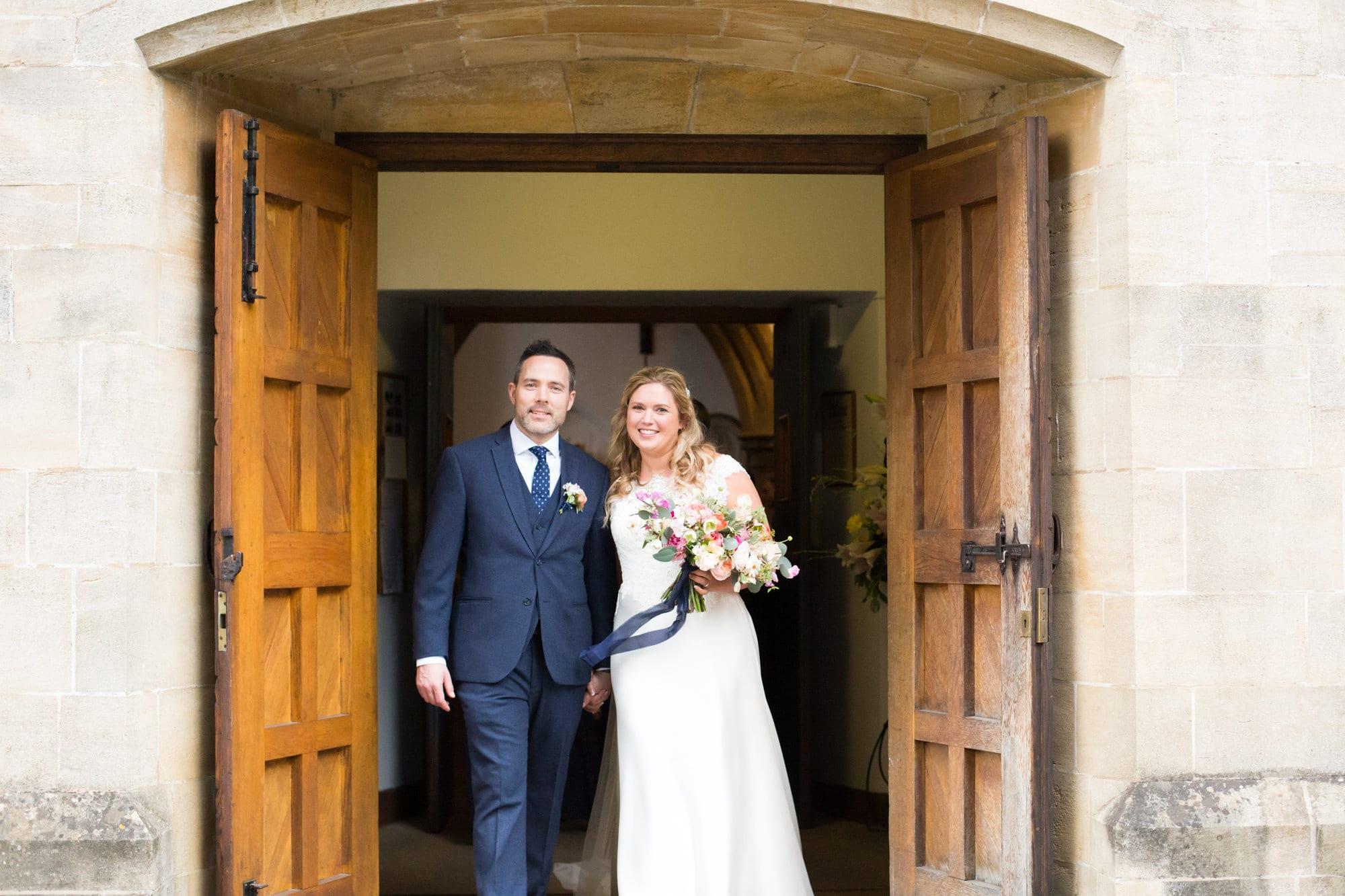 Couple just married standing in church doorway in wedding photo in Bromley, Kent