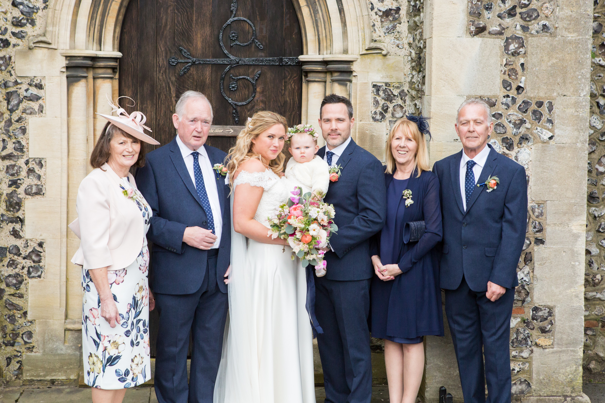 Group shot of wedding guests taken outside church by Bromley wedding photographer