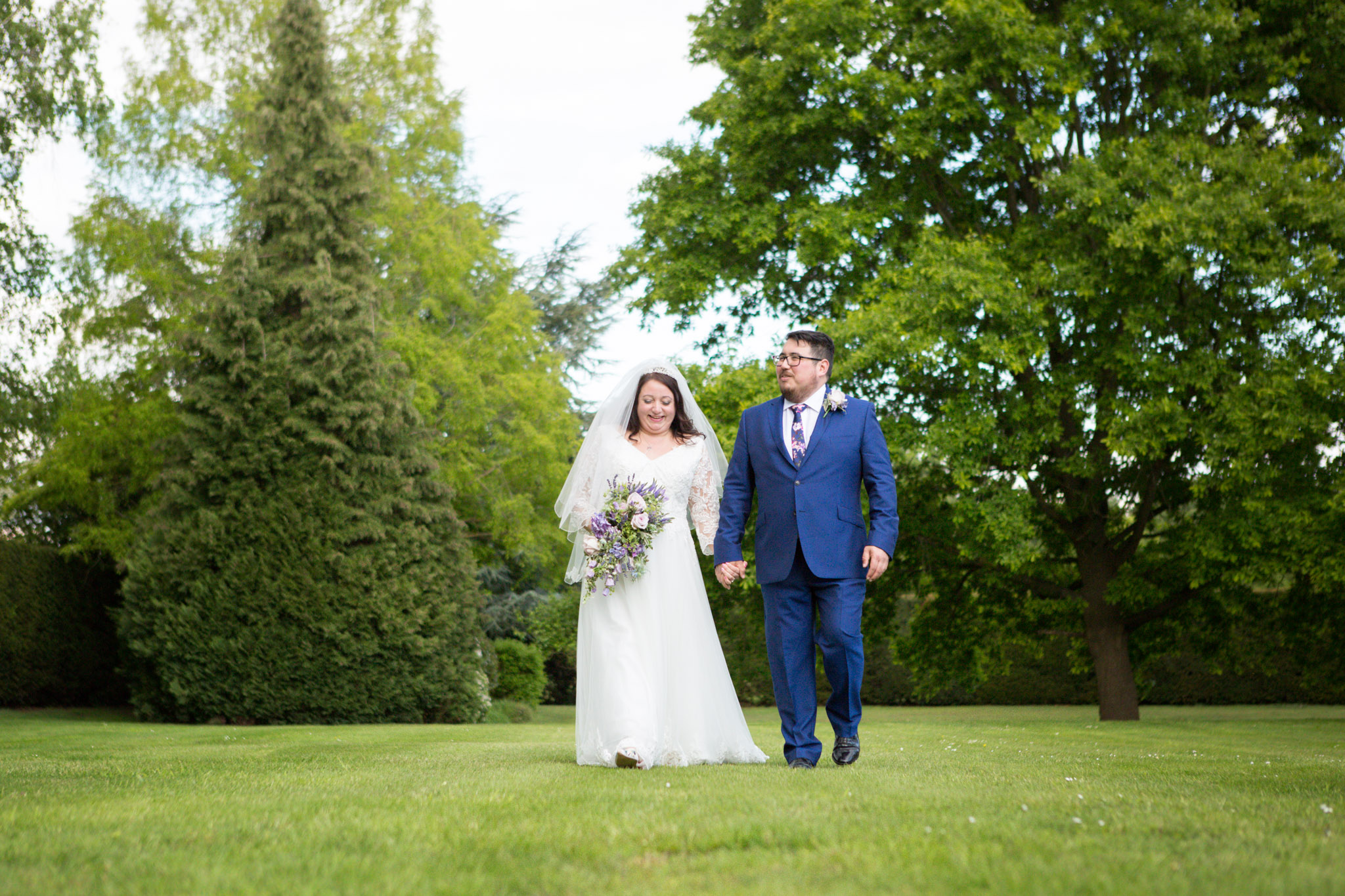 Couple walking in grounds of Oaks Farm Shirley on wedding day