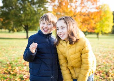 Siblings smiling in Beckenham Autumn mini shoot.