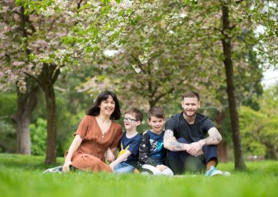 Family photoshoot in Beckenham among spring blossom in Kelsey Park