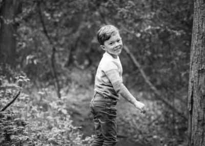 Boy in park in Beckenham Place Park in black and white childrens photo taken by London family photographer