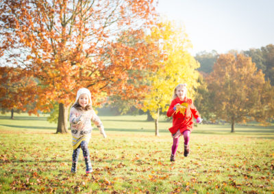 Sisters fun in Autumn in Beckenham park for photoshoot.