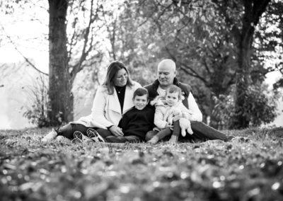 Black and white family phot in Autumn in Beckenham park