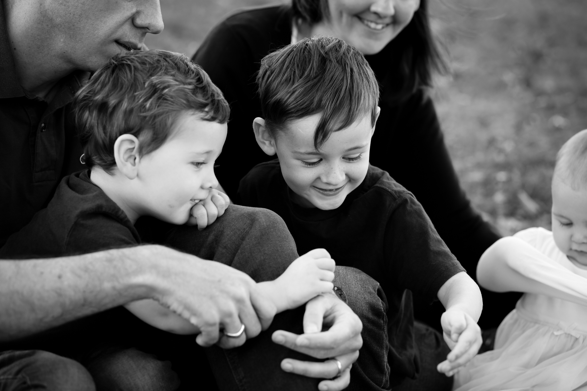 children playing with a bug in the park taken by Bromley photographer