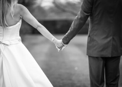 Couple holding hands in wedding photoshoot in Bromley