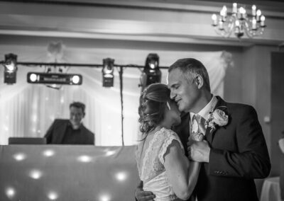 First dance image in black and white of bride and groom at Selsdon Park Hotel, Croydon taken by London Wedding Photographer