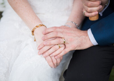 Couple holding hands with wedding rings taken by Bromley Wedding Photographer, Kent