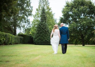 Oaks farm wedding couple walking bride and groom portrait