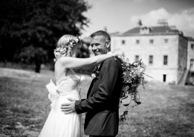 Groom smiling in wedding photo in Beckenham Place Park taken by Bromley wedding photographer