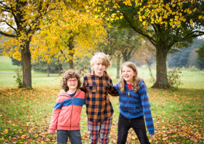 Brothers in the autumn leaves of Beckenham Place Park