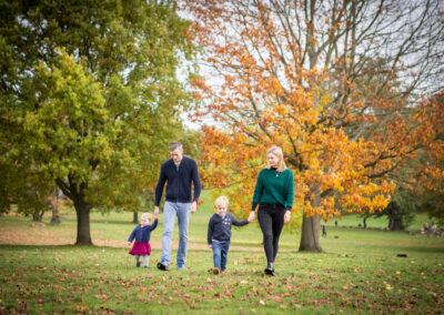 Family walking in park in London photoshoot
